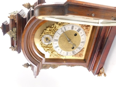A late 19thC German rosewood mantel clock, with gilt metal mounts, the domed top embellished with flame finials, etc., above a arched brass dial with silvered chapter ring and pierced rococo cast spandrels flanked by caryatids, on paw feet, 48cm high. - 3