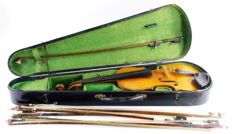 A late 19th/early 20thC violin, with a two piece back, lacking label, (neck AF), length of back 36cm, and a quantity of violin bows, one stamped J. La Salle.
