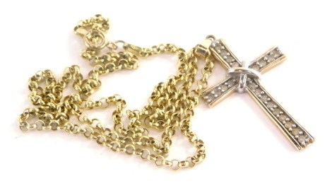 A 9ct gold diamond set crucifix pendant, with central white gold loop over cross, in yellow gold setting, 4.5cm high, on a 9ct gold belcher chain, 42cm long overall, 5.4g all in.