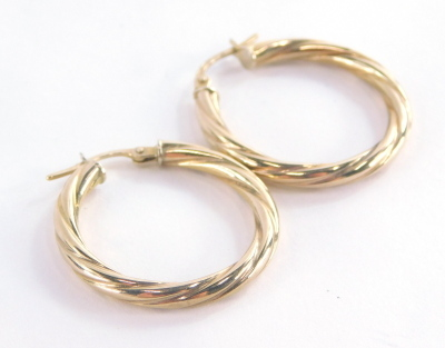 A pair of 9ct gold hoop earrings, each of twist design, 2.5cm high, 1.3g.