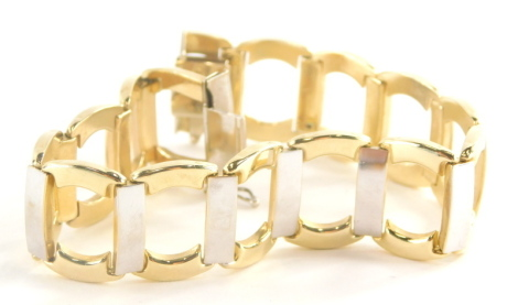 A modern bracelet, of bi colour design with outer yellow gold links, and white gold link bars, yellow metal, stamped 15c, 21cm long, 22.1g.