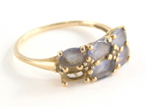 A 9ct gold amethyst dress ring, set with six oval amethysts (1 missing), in claw setting with tiny cz set shoulders, the band fully hallmarked 375 and also stamped 10k, ring size U, 2.5g all in.