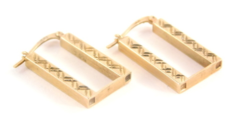 A pair of 9ct gold drop earrings, rectangular, with etched cross detailing, 2.5cm high, 2.1g.