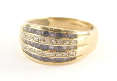 A 9ct gold half hoop dress ring, set with three rows of round brilliant cut amethysts, each in tension setting, and two rows of round brilliant cut diamonds, in claw setting, the band stamped QVC, ring size T ½, 4.5g all in.