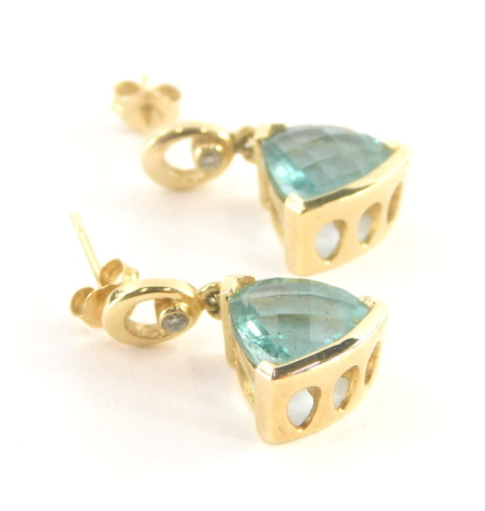 A pair of emerald and diamond drop earrings, the triangle cut emerald drop, in claw setting 9mm x 8.4mm x 6.2mm, with tiny diamond set top loop, the drop 2cm high, each with single pin and butterfly back, yellow metal stamped 14k, 5.6g all in.