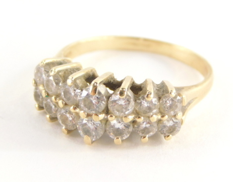 A diamond dress ring, with two rows of round brilliant cut diamonds, each in claw setting, approx 0.05cts each, yellow metal, stamped 585 14kt, ring size P½, 4.3g all in.