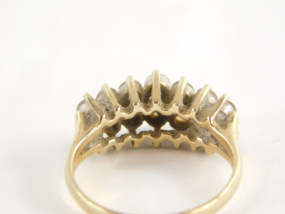 A diamond dress ring, with two rows of round brilliant cut diamonds, each in claw setting, approx 0.05cts each, yellow metal, stamped 585 14kt, ring size P½, 4.3g all in. - 2