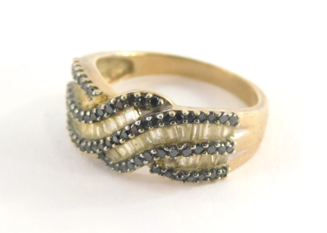 A 9ct gold multi layered dress ring, with sapphire and diamond set ring head marked TGCC, ring size P½, 4.1g all in.