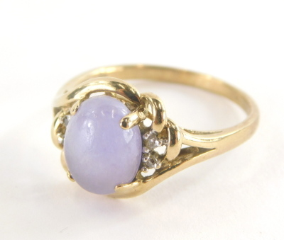 A 9ct gold dress ring, with central pale purple cabachon cut amethyst, and cz set shoulders and twist knot and pierced design splayed metal work, ring size R, 3.2g all in.