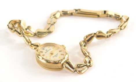 A Sovereign 9ct gold ladies wristwatch, with small circular watch head and tiny diamond set 12 o'clock point, on a pierced design 9ct gold bracelet, 20cm long overall, 9.7g all in.