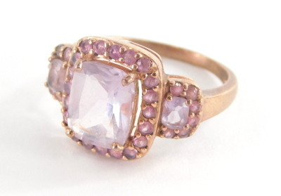 A 9ct rose gold dress ring, set with pink and purple topaz stones, with rectangular central purple stone and outer design round brilliant cut pink stones, in a rose gold coloured setting stamped QVC, ring size P½, 4.9g all in.