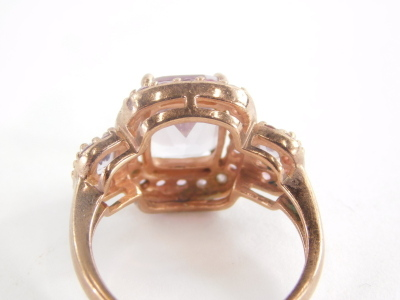 A 9ct rose gold dress ring, set with pink and purple topaz stones, with rectangular central purple stone and outer design round brilliant cut pink stones, in a rose gold coloured setting stamped QVC, ring size P½, 4.9g all in. - 2