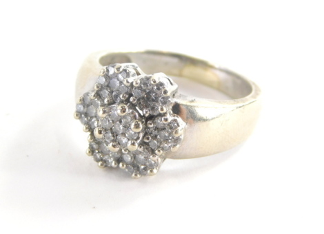 A diamond cluster ring, with six petal flower design, each set with seven round brilliant cut tiny diamonds in claw setting on a white metal band, marked EFFY, 14k, ring size R½, 8.9g all in.