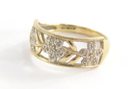 A 9ct gold dress ring, with rectangular panel set with three flowers and six leaf design, each set with cz stones, in oval pierced decoration, ring size R½, 2.7g all in.