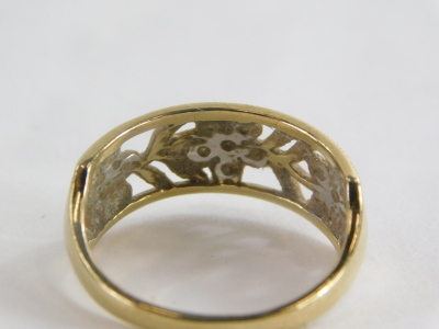 A 9ct gold dress ring, with rectangular panel set with three flowers and six leaf design, each set with cz stones, in oval pierced decoration, ring size R½, 2.7g all in. - 2