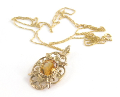 A 9ct gold pendant and chain, the floral pendant set with citrine, 3cm high, on a fine link chain, 46cm long, 2.3g all in.