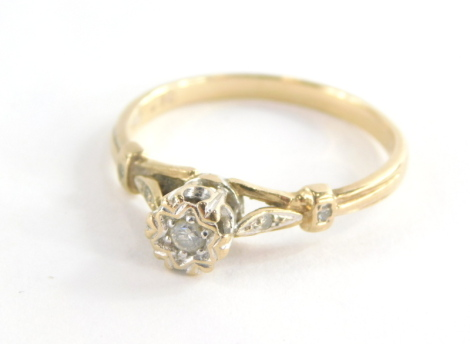 A 9ct gold diamond solitaire ring, on a raised setting with central stone approx. 0.10ct in an illusion oval setting with two tiny diamonds set shoulders, ring size U, 2.6g all in.