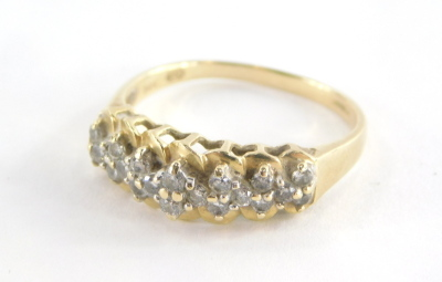 A 15ct gold dress ring, of half hoop design, set with tiny diamonds in claw setting with twist design backing, on a raised and pierced shank, 3.3g all in.