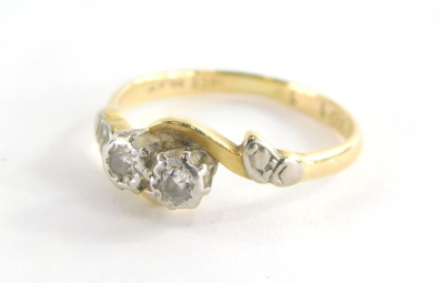 A Victorian 18ct gold and platinum dress ring, the central twist design with two tiny diamonds each in rub over setting, with leaf design borders, maker's stamp WB & Co, ring size I½, 2.3g all in.