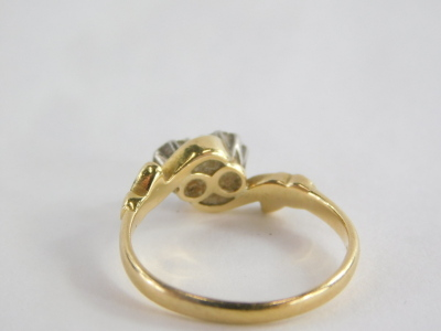 A Victorian 18ct gold and platinum dress ring, the central twist design with two tiny diamonds each in rub over setting, with leaf design borders, maker's stamp WB & Co, ring size I½, 2.3g all in. - 2