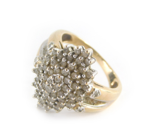 A dress ring, with central cluster design with cz stones and shoulders, on a yellow metal band unmarked believed to be 9ct, ring size Q, 7.2g all in.