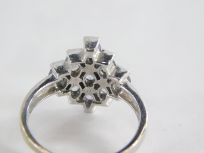 A dress ring, of layered design set with oval pale amethyst with three row central bar, and graduated outer layers, white metal, unmarked, ring size O, 3.6g all in. - 2