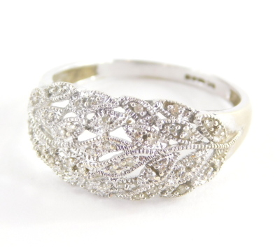 A 9ct gold dress ring, with cross over leaf design, set with tiny diamonds, in a white gold setting, marked QVC, ring size U½, 4.1g all in.