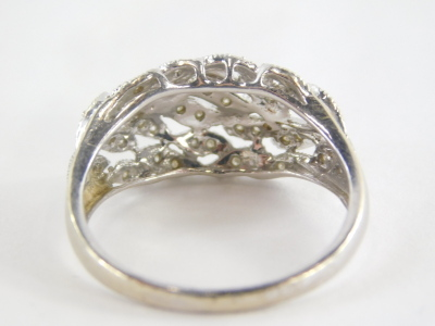 A 9ct gold dress ring, with cross over leaf design, set with tiny diamonds, in a white gold setting, marked QVC, ring size U½, 4.1g all in. - 2