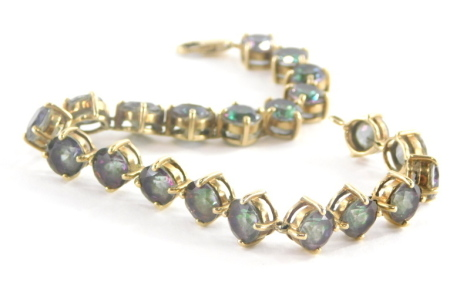 A 9ct gold sunset topaz bracelet, set with circular cut multi faceted topaz, 6.4 x 4.4, the yellow metal bracelet marked 375 to clasp 21cm long, 20g all in.