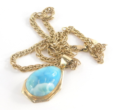 A turquoise set pendant and chain, the egg shaped turquoise set pendant in a yellow metal frame stamped 14K, 4cm high, on a yellow metal multi link chain, 44cm long, yellow metal stamped 375, 17.2g all in.