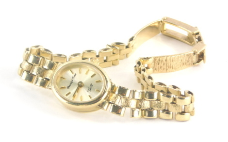 A Prestige Time 9ct gold ladies wristwatch, with small circular watch head, marked 9k 375, on a three bar bark effect design bracelet, marked 9kt, 18.3g all in.