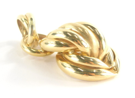 An 18ct gold pendant, of cross and twist loop design, marked Italy, 4.5cm high, 5.4g all in.