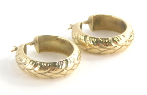 A pair of 9ct gold hoop earrings, each with leaf design, 2.5cm high, 4.8g.