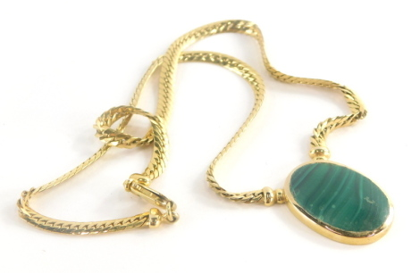 A malachite pendant and chain, the oval malachite in rub over setting, 3cm x 2cm, on an Italian style articulated neck chain, with heavy link clasp, marked 375, 46cm long overall, 26.2g all in.