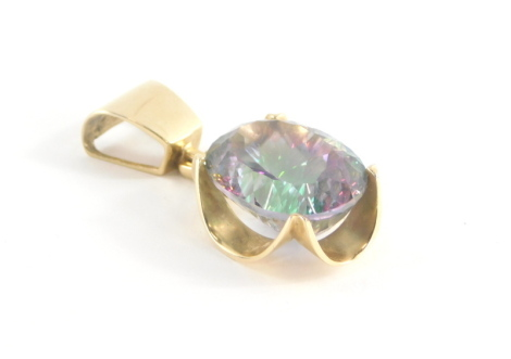 A sunset topaz pendant, with oval multi faceted topaz stone, 18mm x 14mm x 11mm, in a shaped yellow metal pendant with single looped top marked 14ct, 4cm high, 10.2g all in.