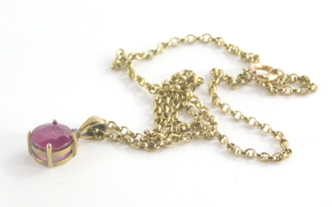 A 9ct gold ruby and diamond pendant and chain, the pendant with round brilliant cut ruby, 9.6mm diameter, 5.4mm deep, with tiny diamond set mount top, the pendant, 2cm high, on a curb link chain marked 375, 66cm long, 7.3g all in.