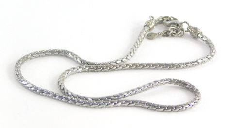 A costume jewellery necklace, in a silvered colour finish, makers stamp JM.