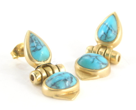 A pair of Eastern design turquoise set drop earrings, each with teardrop shaped design, in matte yellow metal, stamped 585, 2.5cm high, with one butterfly back, 6.3g all in.