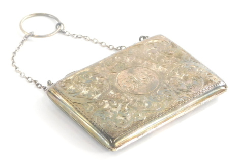 A late 19th/early 20thC silver ladies card case, engraved with scrolls, etc., the cartouche BMJ?, with a brown leather interior, on a silver plated chain, hallmarks indistinct, 9cm long.