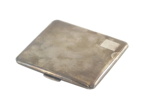 An Elizabeth II silver cigarette case, with engine turned decoration and vacant cartouche, Birmingham 1954, 2¾oz.