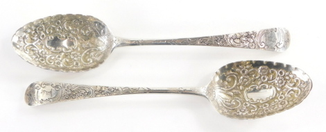 A pair of George III silver tablespoons, by George Smith, the bowl profusely decorated with shells, scrolls, flowers, leaves, the handles decorated with flowers, scrolls, and a cartouche depicting a greyhound, London 1772 and 1776, 3¾oz.