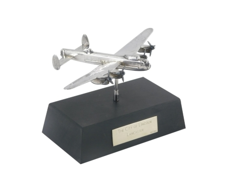 An Elizabeth II silver model of a Lancaster Bomber, on a plinth base, the plaque stating The City of Lincoln Lancaster, limited edition 49/250, Birmingham 1988, 4¾oz, the plane 10cm x 15cm, on the base 9cm high.