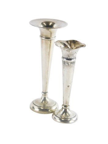 An Elizabeth II silver trumpet shaped vase, base loaded, Birmingham 1957, and another with a fluted rim. (AF)