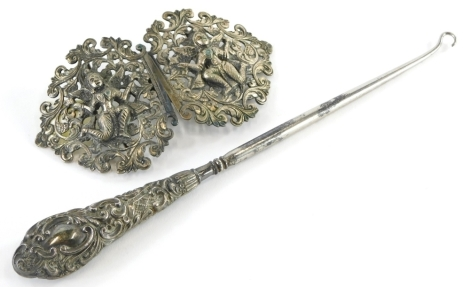 A group of silver and effects, to include a white metal Eastern nurses buckle, with two Medusa style figures, together with a silver handled button hook. (2)