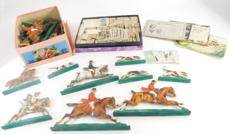 A collection of cigarette cards, some loose, to include Wills Cigarettes, Cavanders Ltd, W D & H O Wills, etc., some sets, and a quantity of mid 20thC carved hunting and horse figures with paper applied decoration. (1 tray)