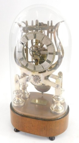A 19thC brass skeleton clock by Haynes of Stamford, under a glazed dome, on a mahogany and ebony and boxwood cross banded border, terminating in four feet, the clock with a 10cm Roman numeric dial, 35cm high overall.