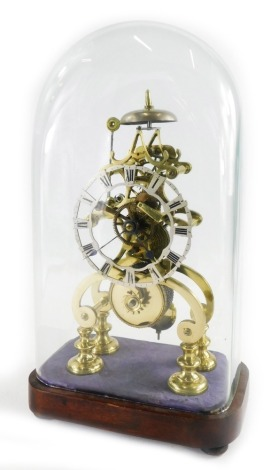 A 19thC brass skeleton clock, under a glazed dome, on a mahogany base, with a 12cm Roman numeric dial, 39cm high overall.