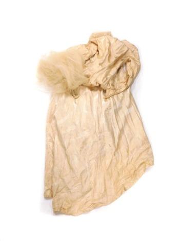 A gold coloured damask ladies wedding dress and veil. (AF)