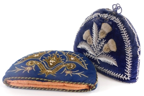 A Victorian beadwork tea cosy, backed on blue velvet decorated with thistles etc., and a further teapot cosy, on blue felt decorated with embroidery and with mother of pearl embellishments, etc. (2)