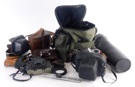 A collection of cameras, binoculars etc., to include a Kodak Brownie camera, a Prakica camera, binoculars in leather case, etc. (1 tray)